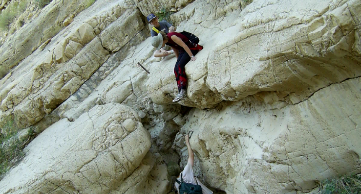 Climbing down one of the rock faces in Nahal Dargot